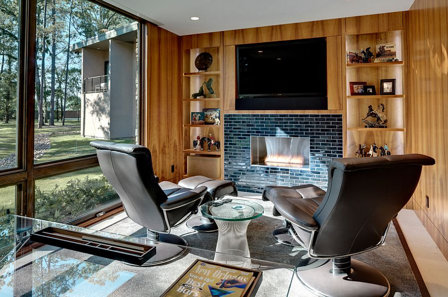 Home office with hidden TV above the fireplace [Design: Linda Fritschy Interior Design]