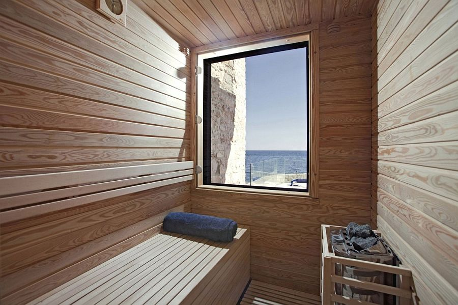 Home sauna with a sea view window