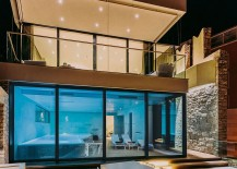 Indoor pool with retractable glass doors and lovely lighting