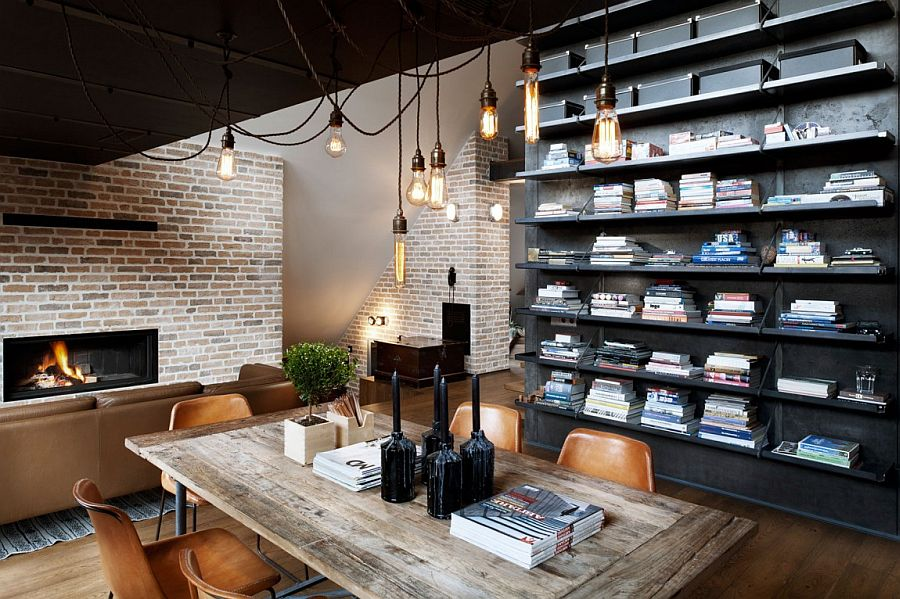 Industrial style bulb lighting above the small dining space