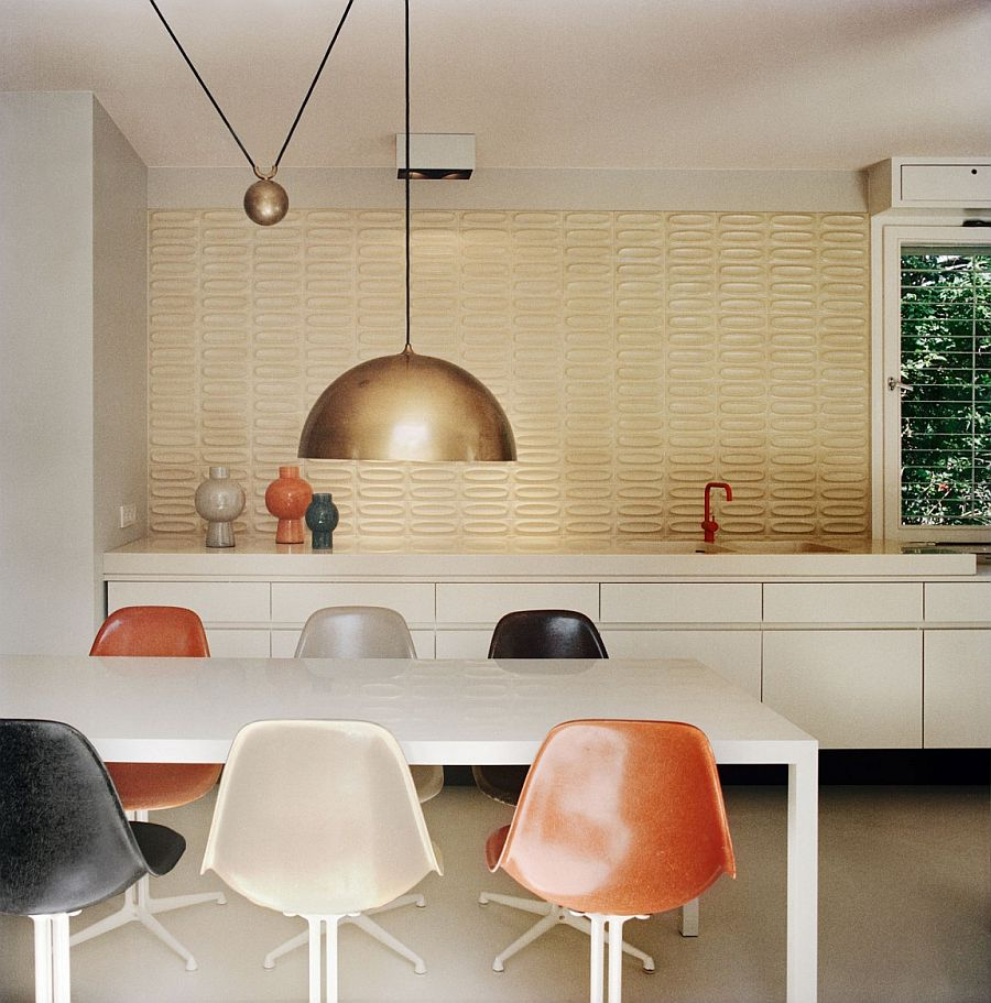 Ingenious pendant lighting and lovely tiled backdrop bring back the essence of the 60s