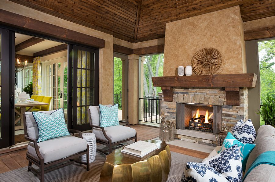 Inimitable gold coffee table for the cozy porch with plush seating and fireplace [From: LandMark Photography]  50 Fabulous Coffee Tables that Usher in a Golden Glint Inimitable gold coffee table for the cozy porch with plush seating and fireplace