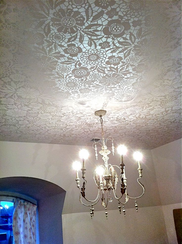 Lace Ceiling Treatment Lit Up With Chandelier