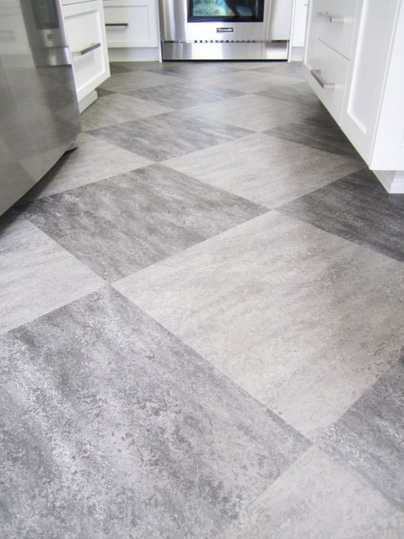 Make a statement with large floor tiles for White kitchen vinyl floor