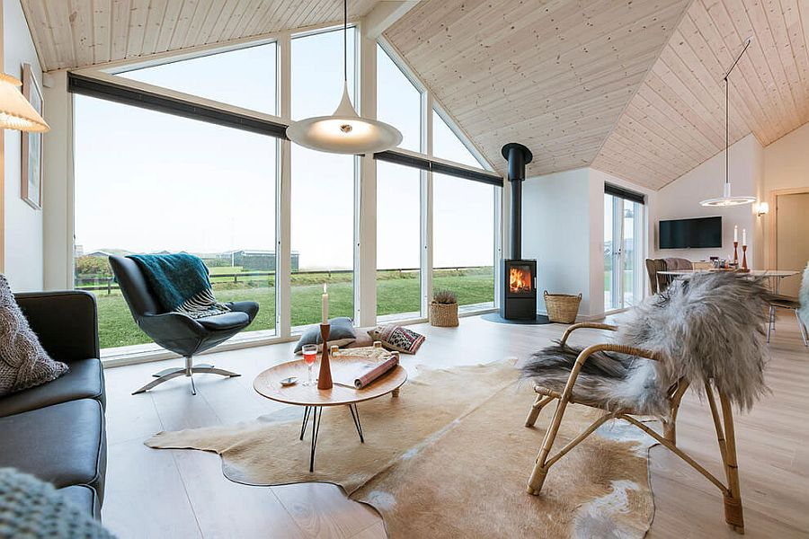 Large glass windows and stunning gabled roof design define the summer home