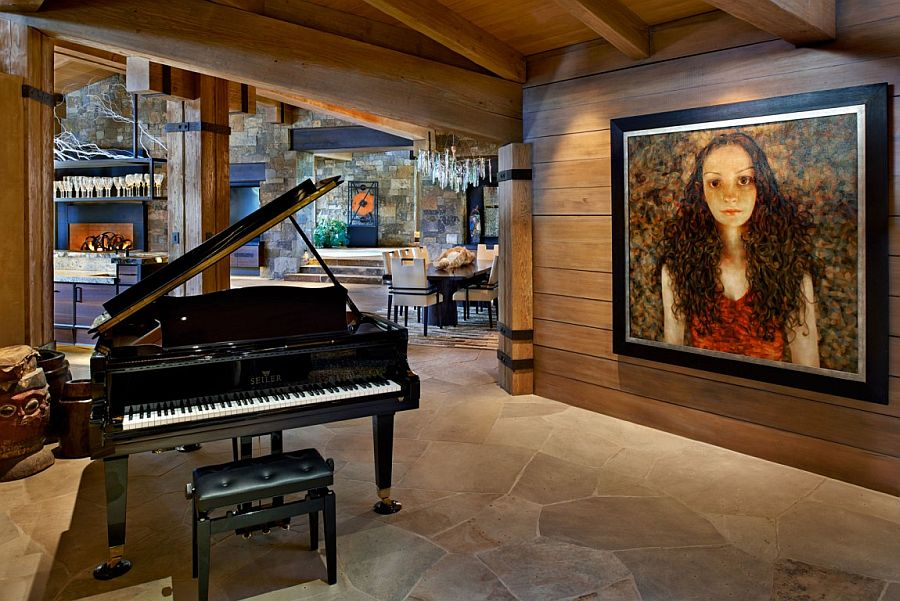 Large portrait and grand piano bring elements of classic design to the woodsy mansion
