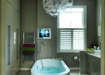 Large tile flooring in a comfy modern bathroom 217x155 Make a Statement with Large Floor Tiles