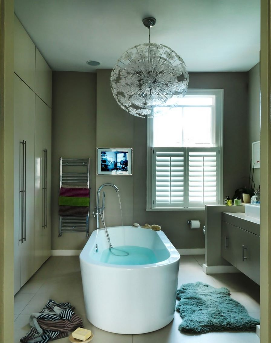 Large tile flooring in a comfy modern bathroom