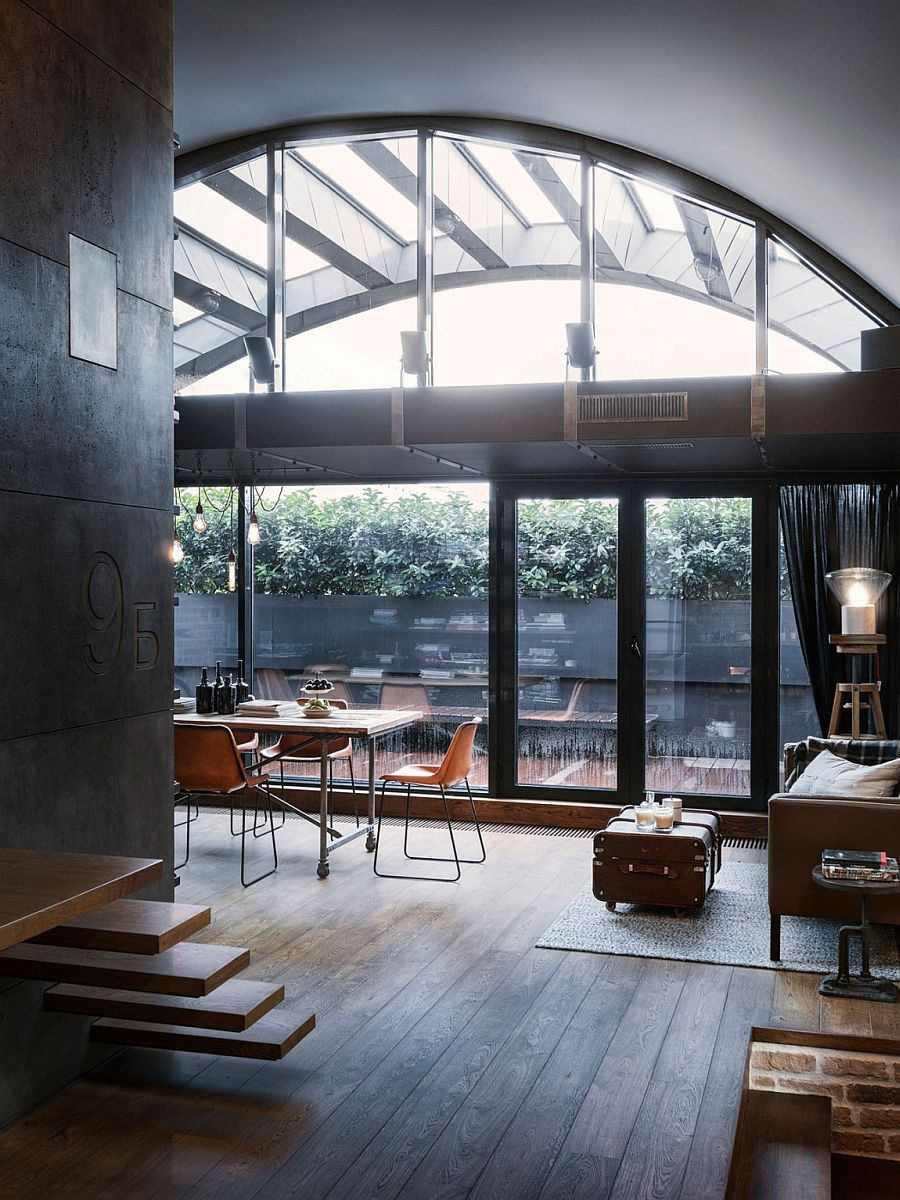 Large windows with dark frames lead to the private balcony