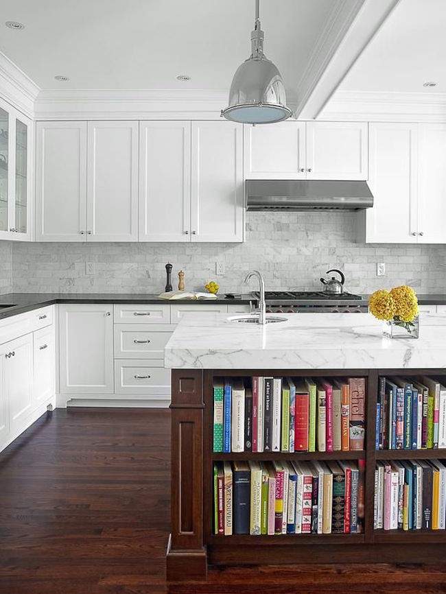 Library-style bookshelves built into kitchen island