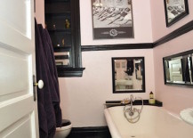 Light pink and black bathrom with retro wall art 217x155 Spectacularly Pink Bathrooms That Bring Retro Style Back