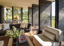 Lovely sitting area and dining space for sunroom with wooden shutters