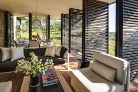Lovely sitting area and dining space for sunroom with wooden shutters  50 Bright and Beautiful Contemporary Sunrooms Lovely sitting area and dining space for sunroom with wooden shutters 270x180