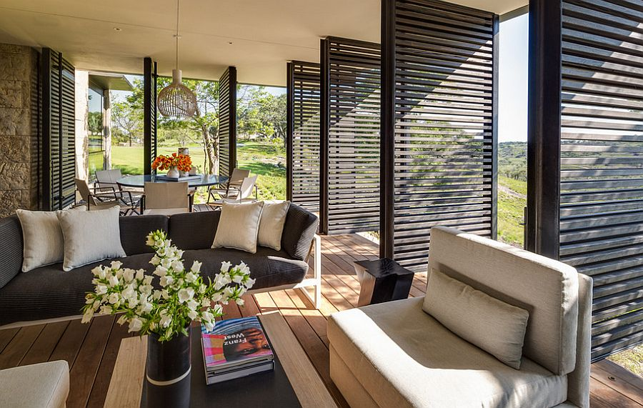 Lovely sitting area and dining space for sunroom with wooden shutters [Design: BK.Architect ]