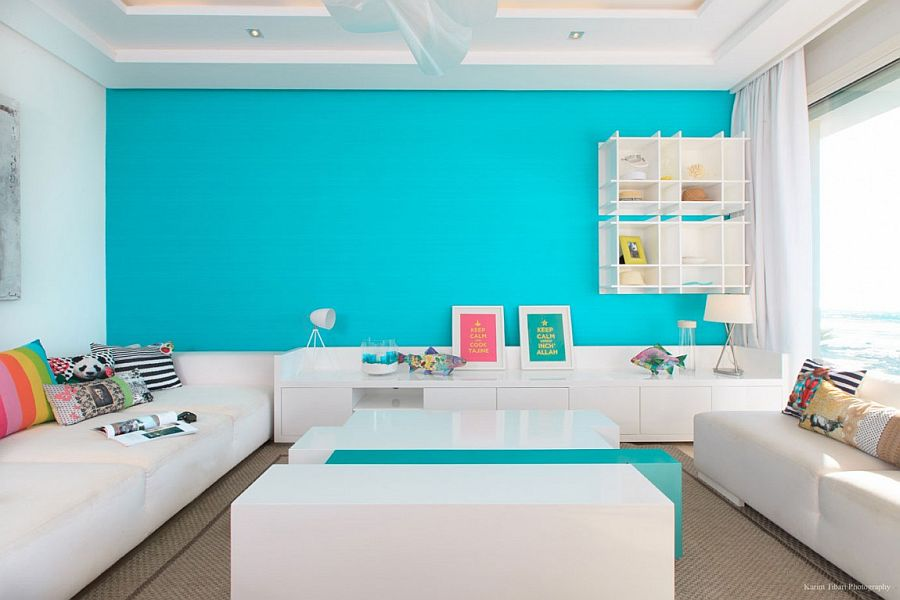 Lovely splash of turquoise in the living room creates a vivacious accent wall