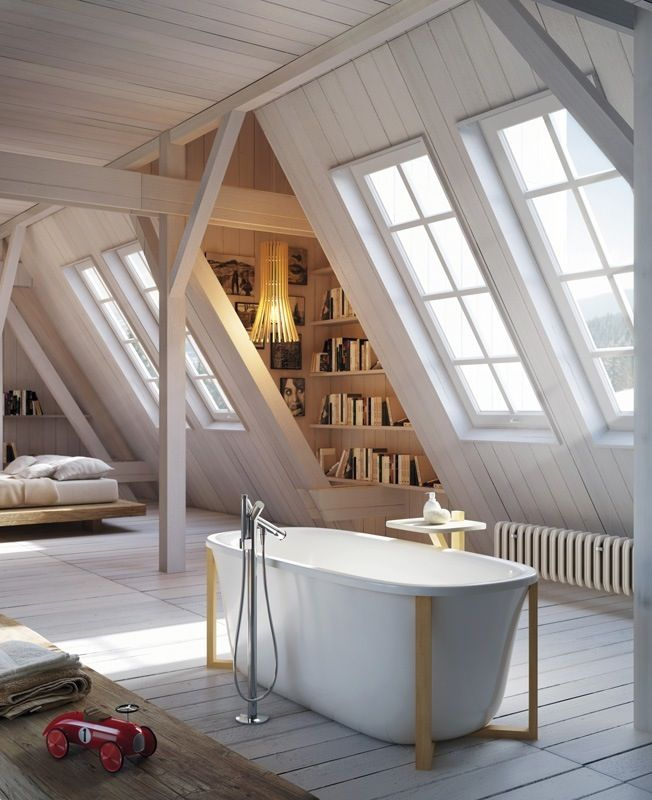 Luxurious soaking tub in the middle of a large attic