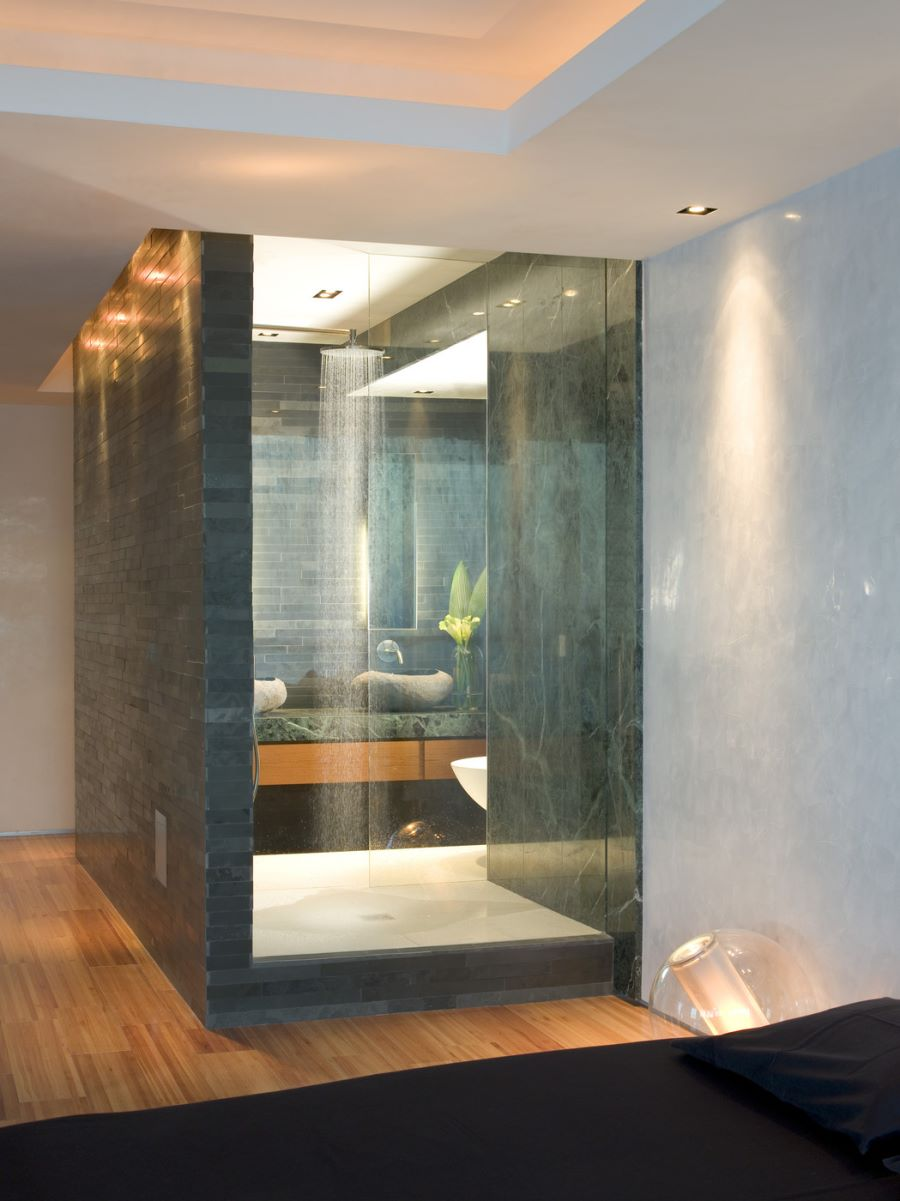 Luxury shower featuring green marble
