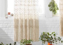 Macrame-wall-hanging-against-a-white-brick-wall-217x155