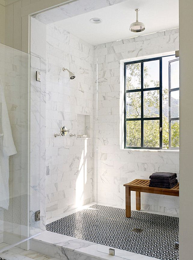 Marble tile shower with a patterned floor