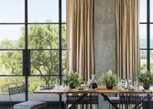 Metal factory windows bring industrial elemnt to the rustic home