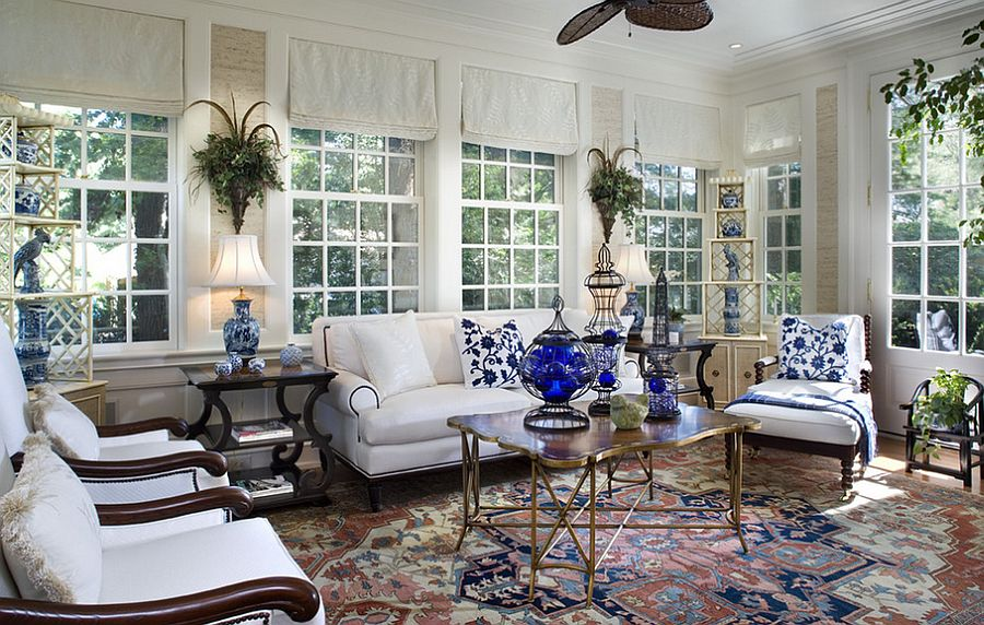 Metallic coffee table brings cheerful charm to the breezy sunroom [Design: Diane Burgoyne Interiors]