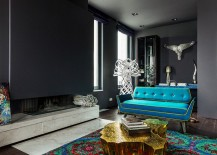 Modern apartment living room in gray with gold coffee table and a teal couch
