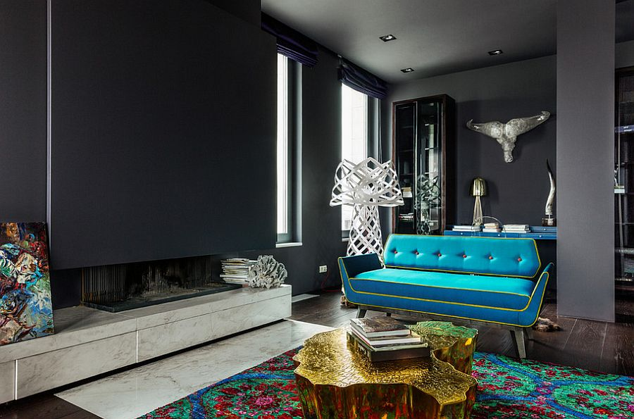 Modern apartment living room in gray with gold coffee table and a teal couch [From: luján + sicilia]