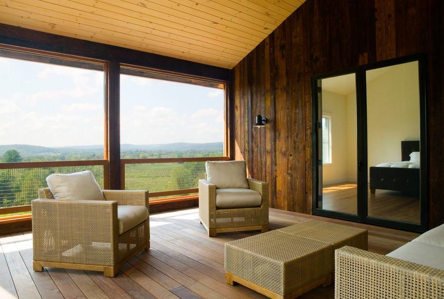 Modern furniture on a farmhouse porch