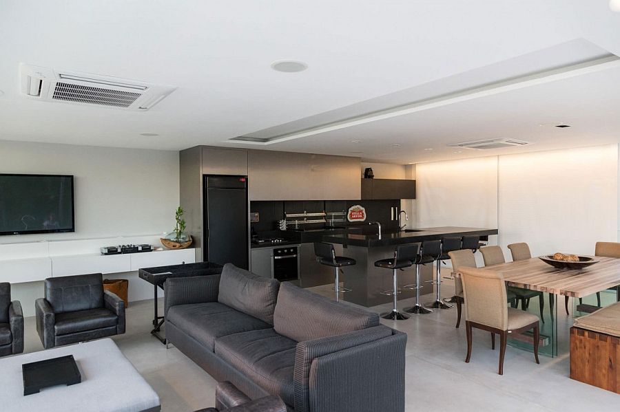 Modern kitchen, dining and living areas of the pool house