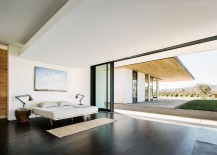 Modern minimal bedroom that opens up towards the vineyards outside