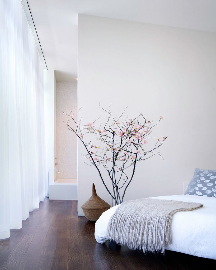 Modern vase of bedside cherry blossoms
