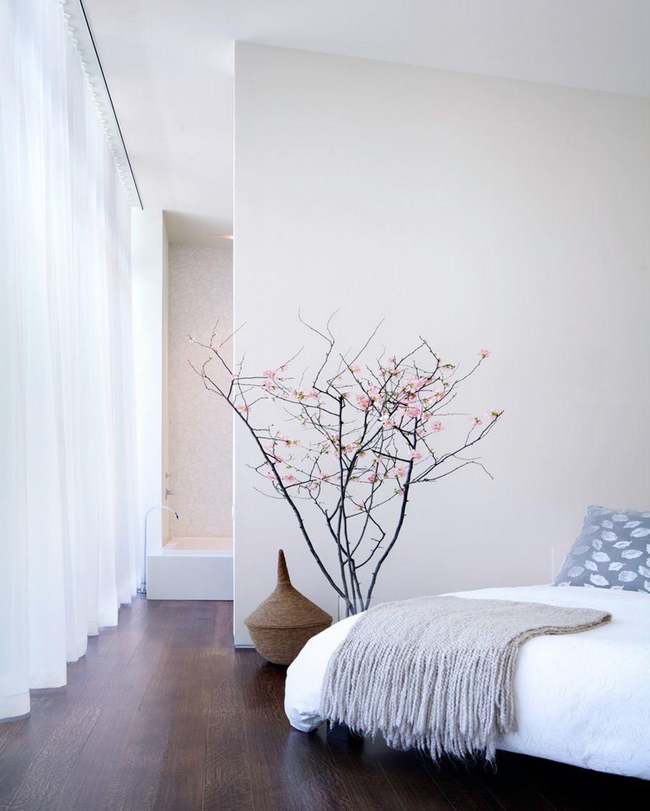 Modern vase of bedside cherry blossoms