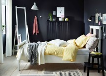 NYPONROS bed frame stands in contrast to the dark backdrop and sideboard