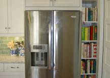 Narrow-shelving-built-into-cupboares-beside-fridge-217x155