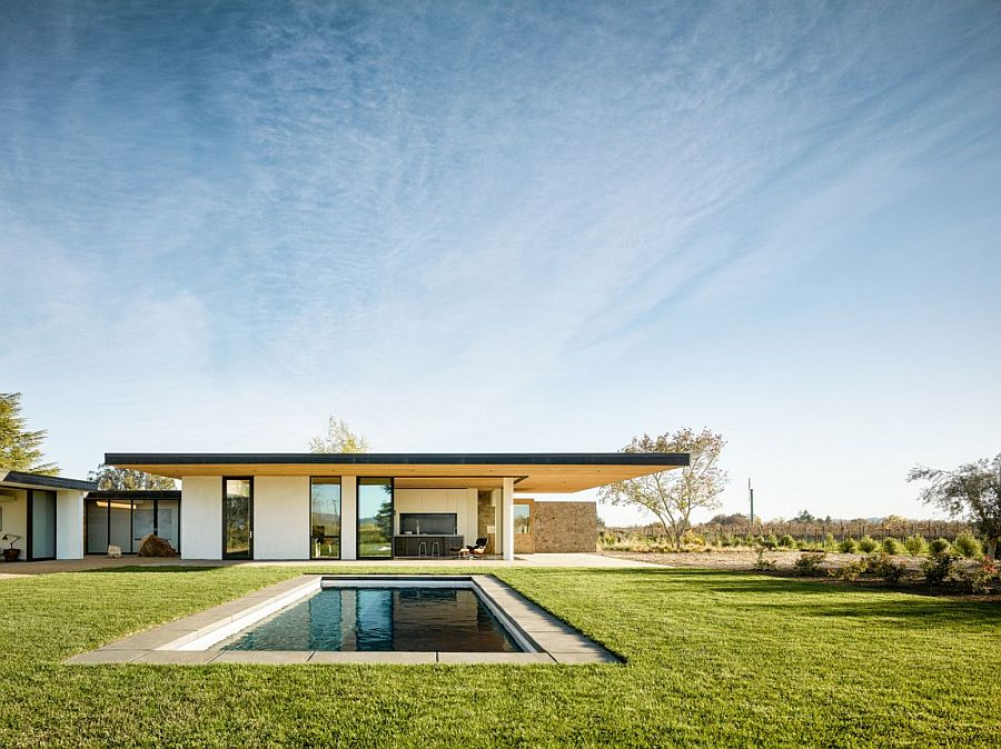 Natural vineyards and greenery surround the lovely California home