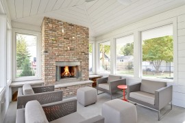 Neutral hues and brick fireplace shape sunroom with Scandinavian flair [Design: Refined LLC]  50 Bright and Beautiful Contemporary Sunrooms Neutral hues and brick fireplace shape sunroom with Scandinavian flair 270x180