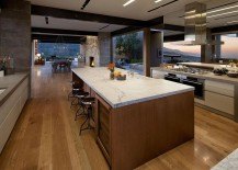 Open courtyards and openings bring the view into the kitchen