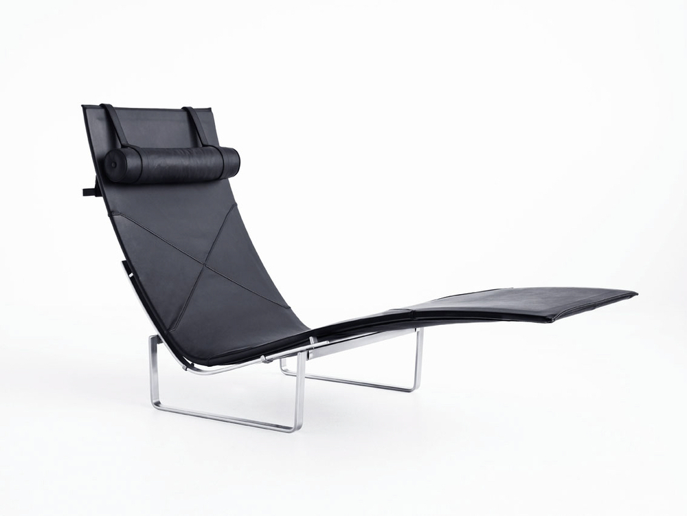 PK24, designed by Danish Poul KjÊrholm in 1965. Introduced with black leather in 2007 for the Autumn/Winter Collection 2007. Also Available in wicker with headrest in leather. Base is stainless steel.