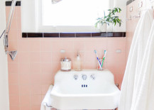 Pink and black bathroom with an original retro sink
