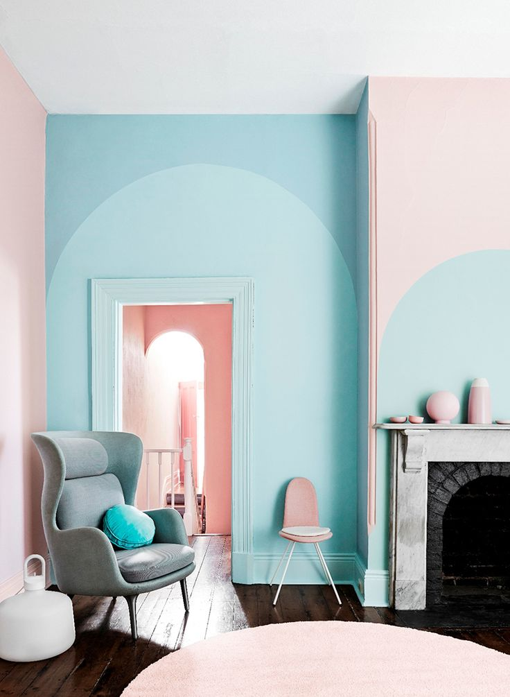 Pink and blue color blocked paint with arc designs