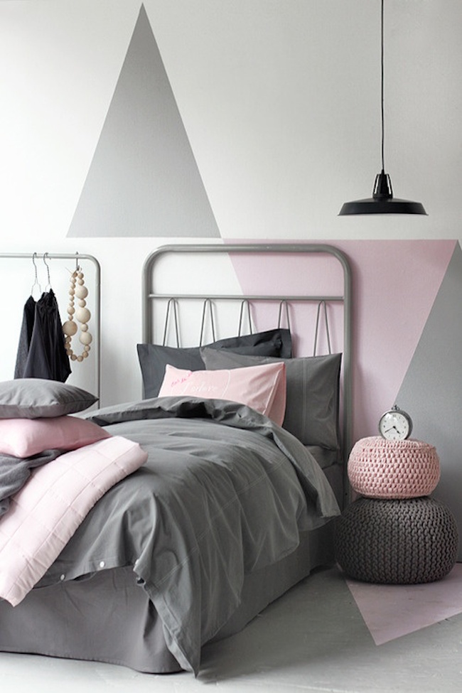 Pink and gray bedroom with triangular color blocking