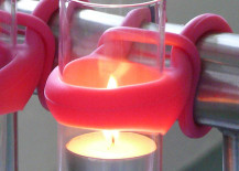 Pink holder to hang tea light candles on a balcony 217x155 Creative Outdoor Accessories to Hang from Your Balcony Railing