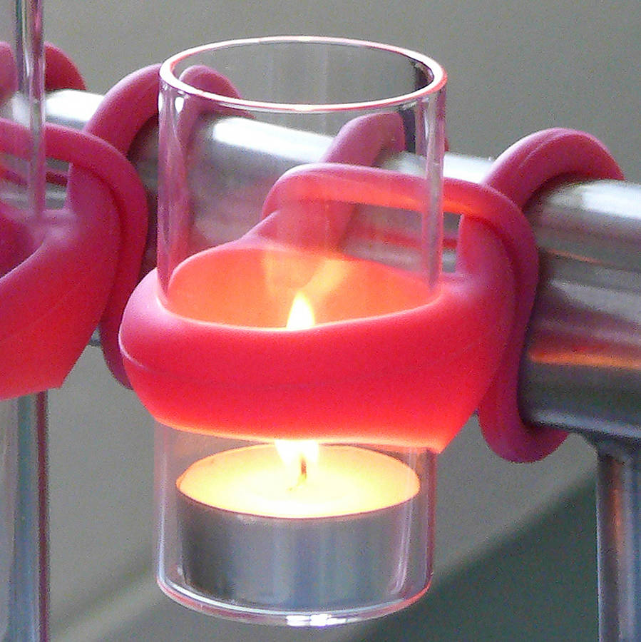 Pink holder to hang tea light candles on a balcony