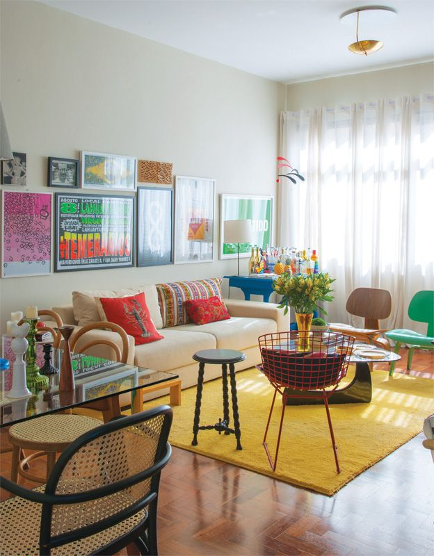 Plain, bright yellow area rug in colorful living room
