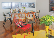 Plain, bright yellow rug separates living room from dining room