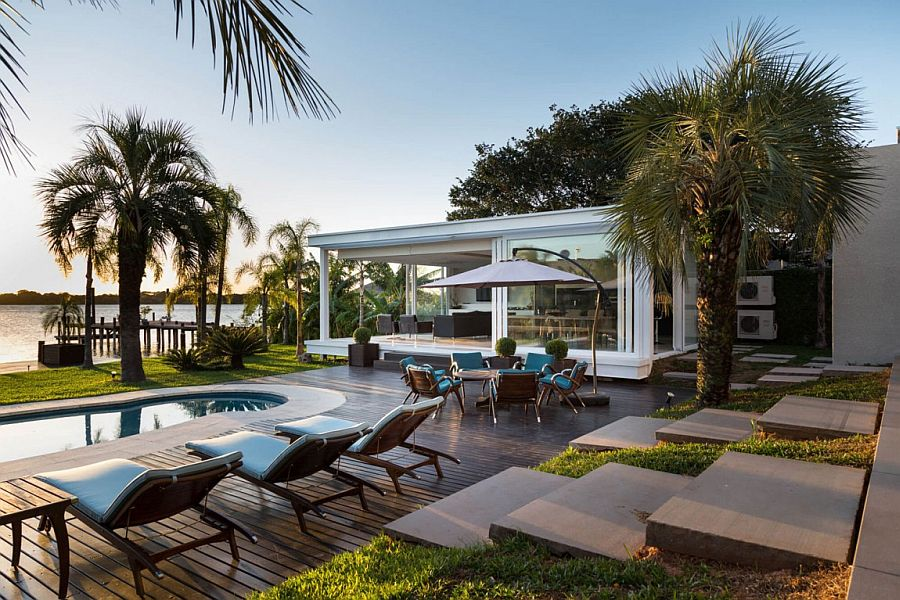 Poolside hangout and sitting area of the lakeside home Dream Hangout: Contemporary Pool House in Porto Alegre Unveils Lakeside Paradise!
