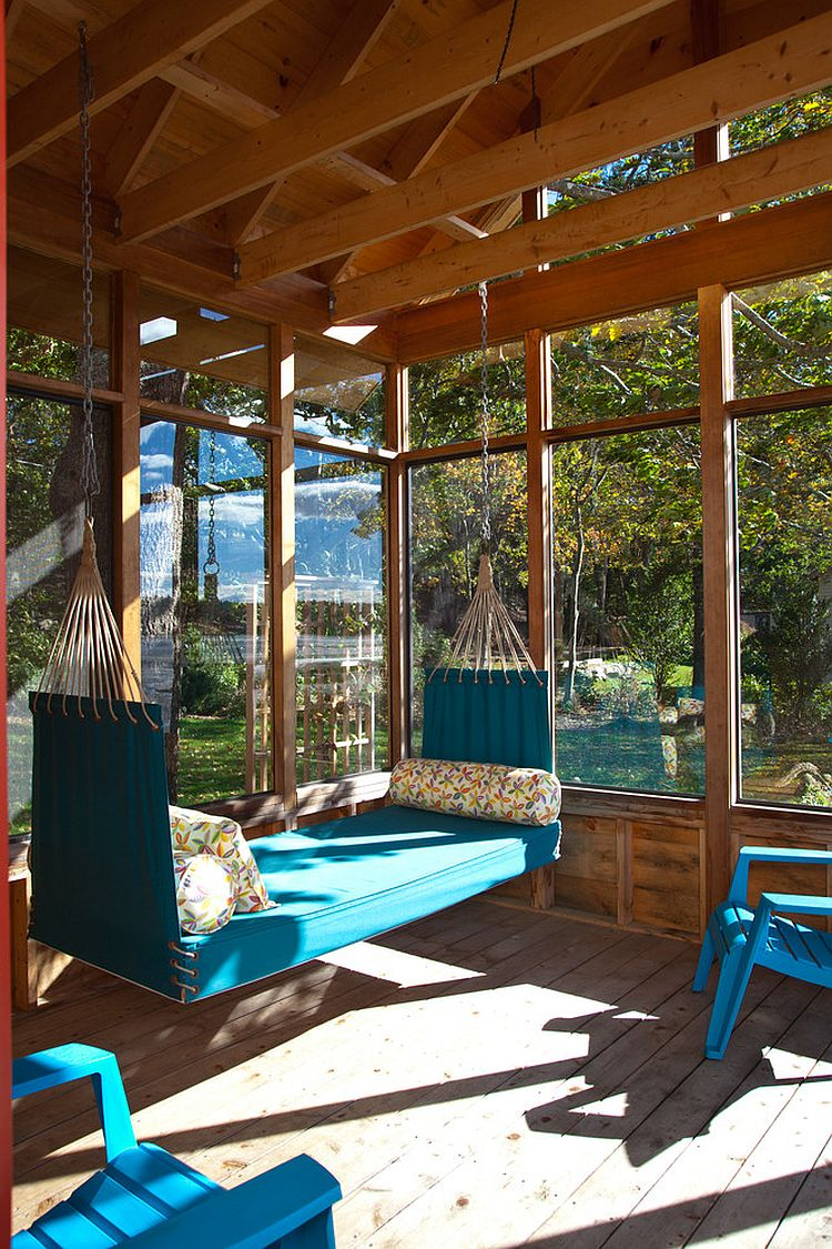 Porch swing offers a comfy seating option in the sunroom