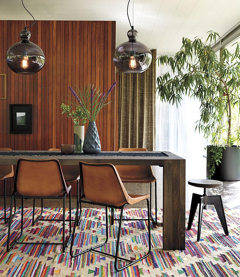 Potted plants and vase greenery add life to this modern dining room
