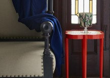 Red quatrefoil table in an entryway 217x155 Entryway Furniture Ideas That Maximize Style