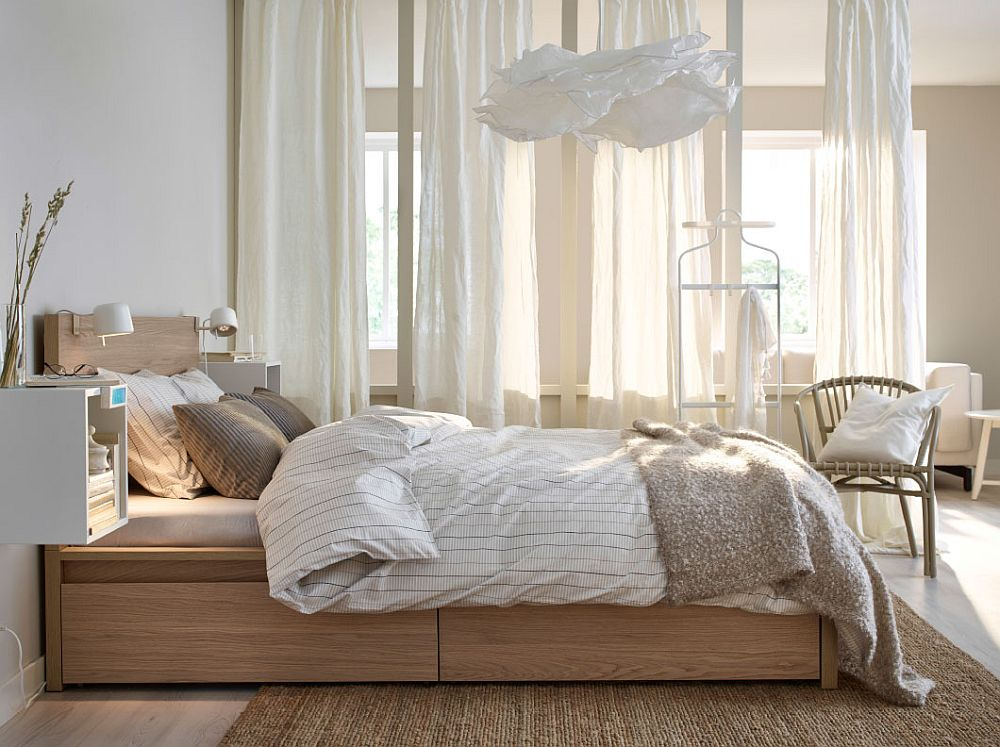 Relaxing bedroom with wall-mounted, beautiful bedside stands and white drapes